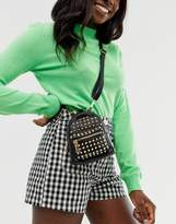 Steve Madden Bbruno black studded backpack with dual use cross body strap