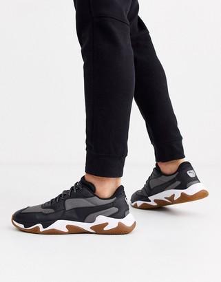 Puma Storm Origin sneakers with gum sole black