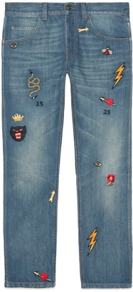Gucci Tapered denim trousers with symbols
