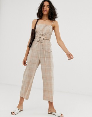Asos DESIGN strappy jumpsuit with corset tie detail in summer check print