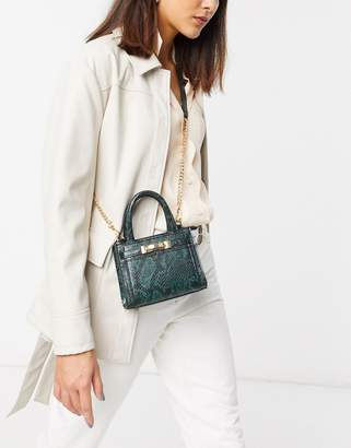 Topshop mini crossbody bag in green snakeskin