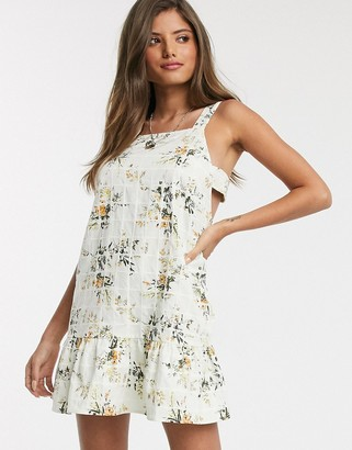 ASOS DESIGN mini sundress with pephem in floral print grid texture