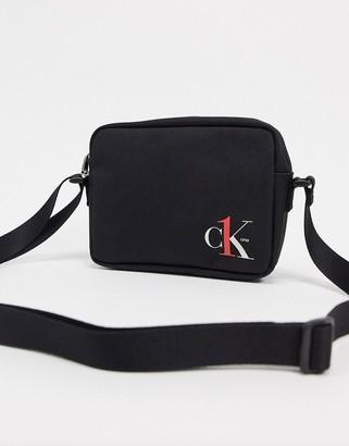 Calvin Klein Jeans CK1 logo camera bag in black