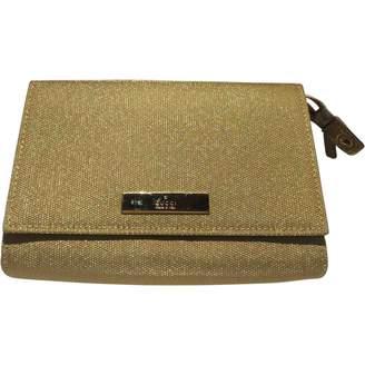 Gucci Gold Cloth Clutch bags