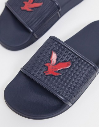 Lyle & Scott Eddie logo slider in navy