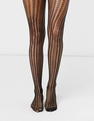 Gipsy patterened lace fishnet tights in black