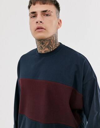 Asos DESIGN oversized longline long sleeve t-shirt with waffle body panel in navy