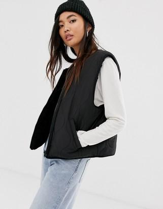 Weekday reversible sleeveless jacket in black