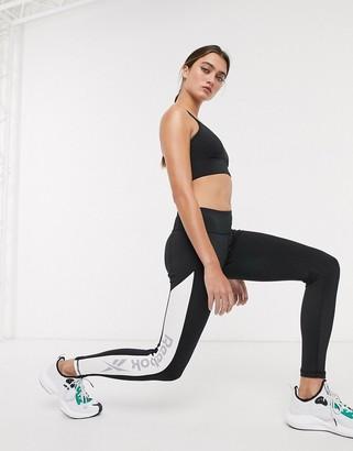 Reebok Training leggings in black with contrast side panel