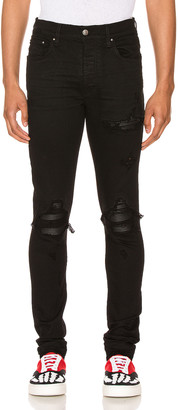 Amiri MX1 Leather Patch Skinny Jeans in Black | FWRD
