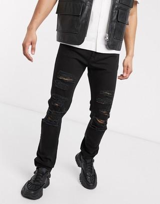 Versace ripped slim fit jean in black