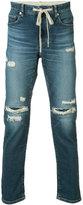 Attachment distressed slim-fit jeans - men - Cotton/Polyurethane - 1