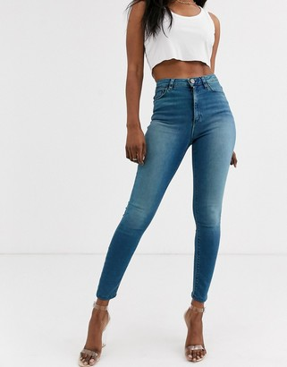 Asos Design DESIGN Ridley high waisted skinny jeans in sea blue wash