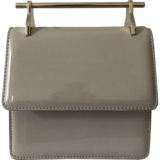 M2Malletier Beige Patent leather Handbags