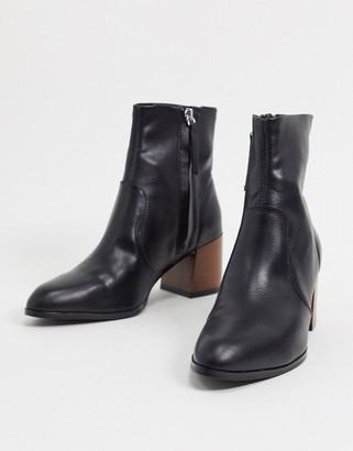 ASOS DESIGN Reporter heeled boots with flared wooden heel in black