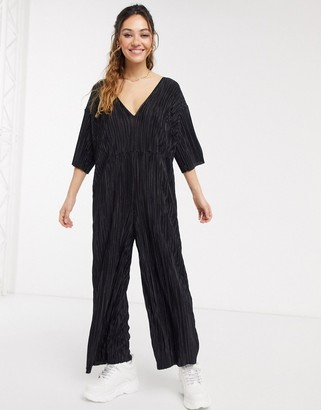 Another Reason wide leg plisse jumpsuit with deep plunge