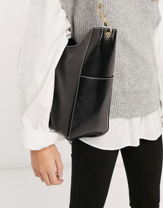 ASOS DESIGN glossed black shopper with side pockets and chain strap
