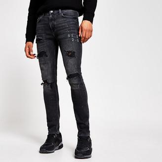 River Island Black ripped Sid super skinny jeans