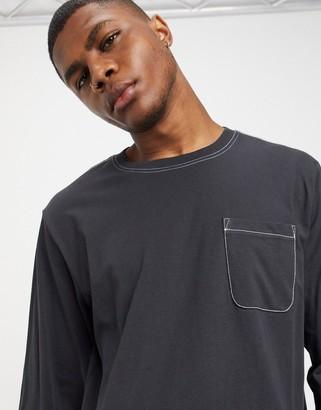 Weekday Jayden long sleeve top in dark grey with pocket