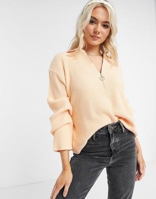 ASOS DESIGN oversize jumper with zip front detail and open collar in light orange