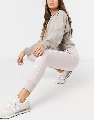 New Balance stacked logo joggers in pink