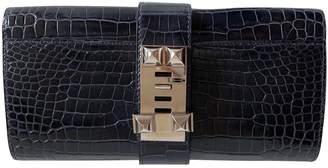 Hermes Medor Navy Crocodile Clutch bags