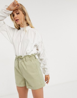 Only high neck blouse with ruffle detail in white