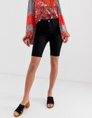 Free People So Chic Biker longline denim short in black