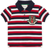 Gucci Baby striped cotton polo with crest
