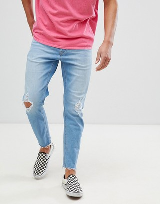 Asos Design DESIGN stretch tapered jeans in vintage light wash with rips