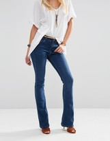 Asos Baby Kick Flare Jeans In Vintage Wash With Bleach Crease