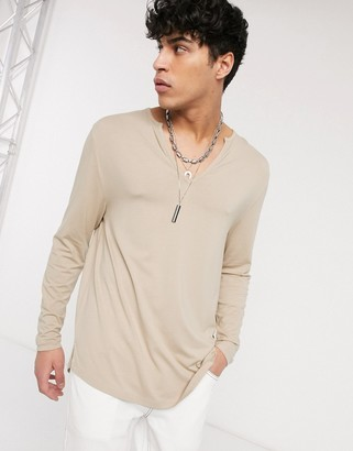 ASOS DESIGN relaxed longline long sleeve jersey t-shirt in beige