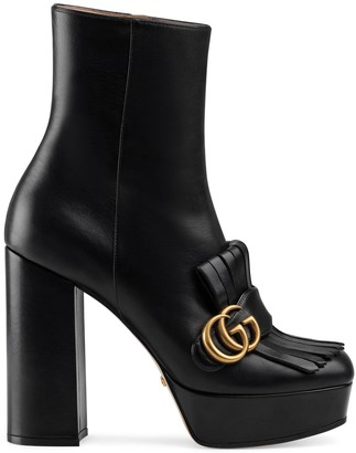 Gucci Leather platform ankle boot with fringe
