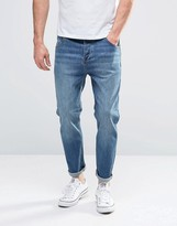 Asos Tapered Jeans In Mid Blue