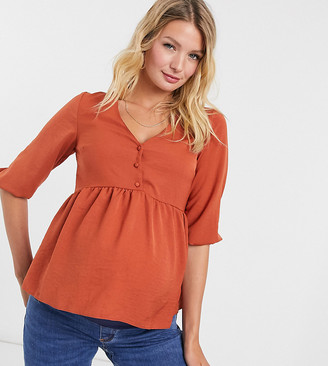 New Look Maternity button detail peplum top in rust