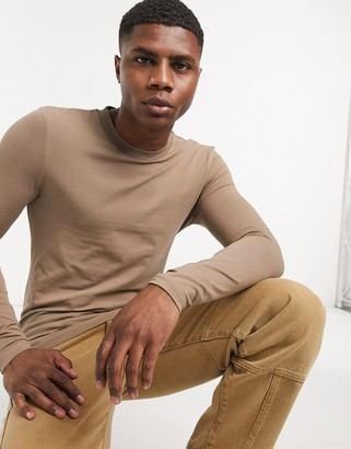 ASOS DESIGN muscle fit long sleeve t-shirt with crew neck in brown