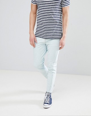 ASOS DESIGN Skinny Twisted Seam Jeans In Mid Wash Blue With Raw Hem