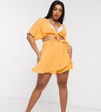 Asos DESIGN curve tie side wrap sarong beach skirt in pastel orange crinkle
