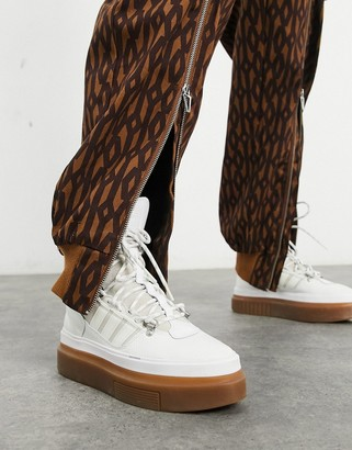 Ivy Park adidas x Super Sleek boots in core white with contrast sole