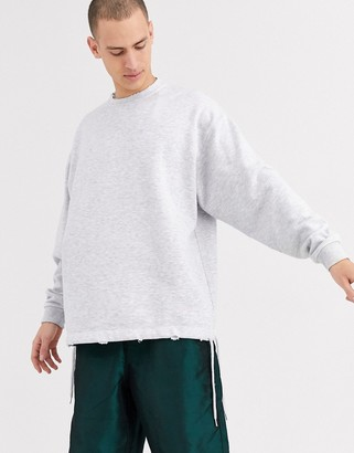Asos Design DESIGN long sleeve oversized sweatshirt with distressing in white marl