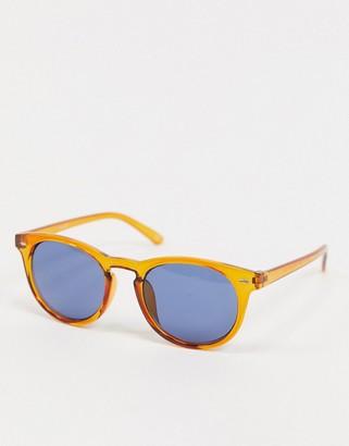 ASOS DESIGN round sunglasses in orange plastic with blue lens