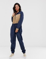 Daisy Street contrast color block boilersuit with high neck in navy and tan