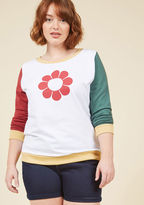 F8022C This colorblock sweatshirt has taken flower power to the next level of stylishness! Brick red and pine green sleeves stem from the white body of this yellow-trimmed top, while a bold blossom and cotton construction secure this ModCloth exclusive as the mo