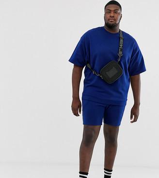 Asos Design DESIGN Plus tracksuit short sleeve oversized sweatshirt/skinny short in bright navy