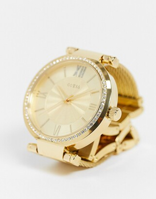 GUESS watch with gold strap and dial