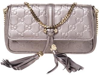Gucci Metallic Leather Tassel Pochette Bag