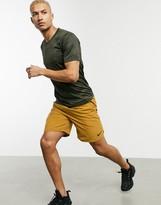 Nike Training Flex woven shorts in tan