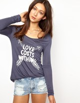 Delicious Love Costs Nothing T-Shirt with Long Sleeves