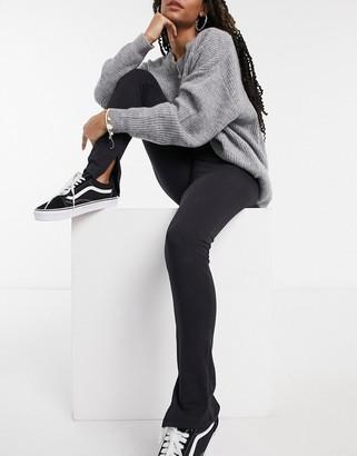 Only leggings with slit hem in black