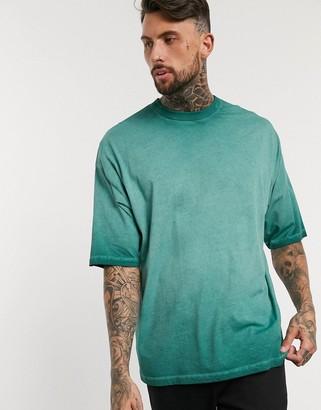 ASOS DESIGN oversized t-shirt with half sleeve in dark green pigment wash